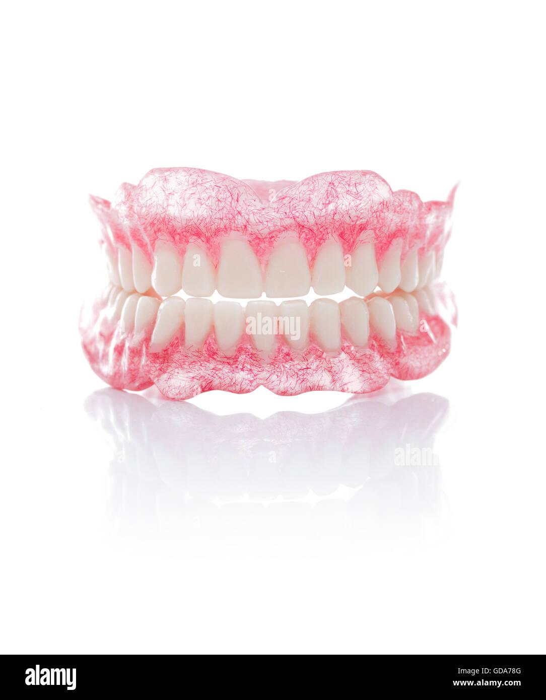 A Set of Full Dentures Isolated on White Background - Stock Image