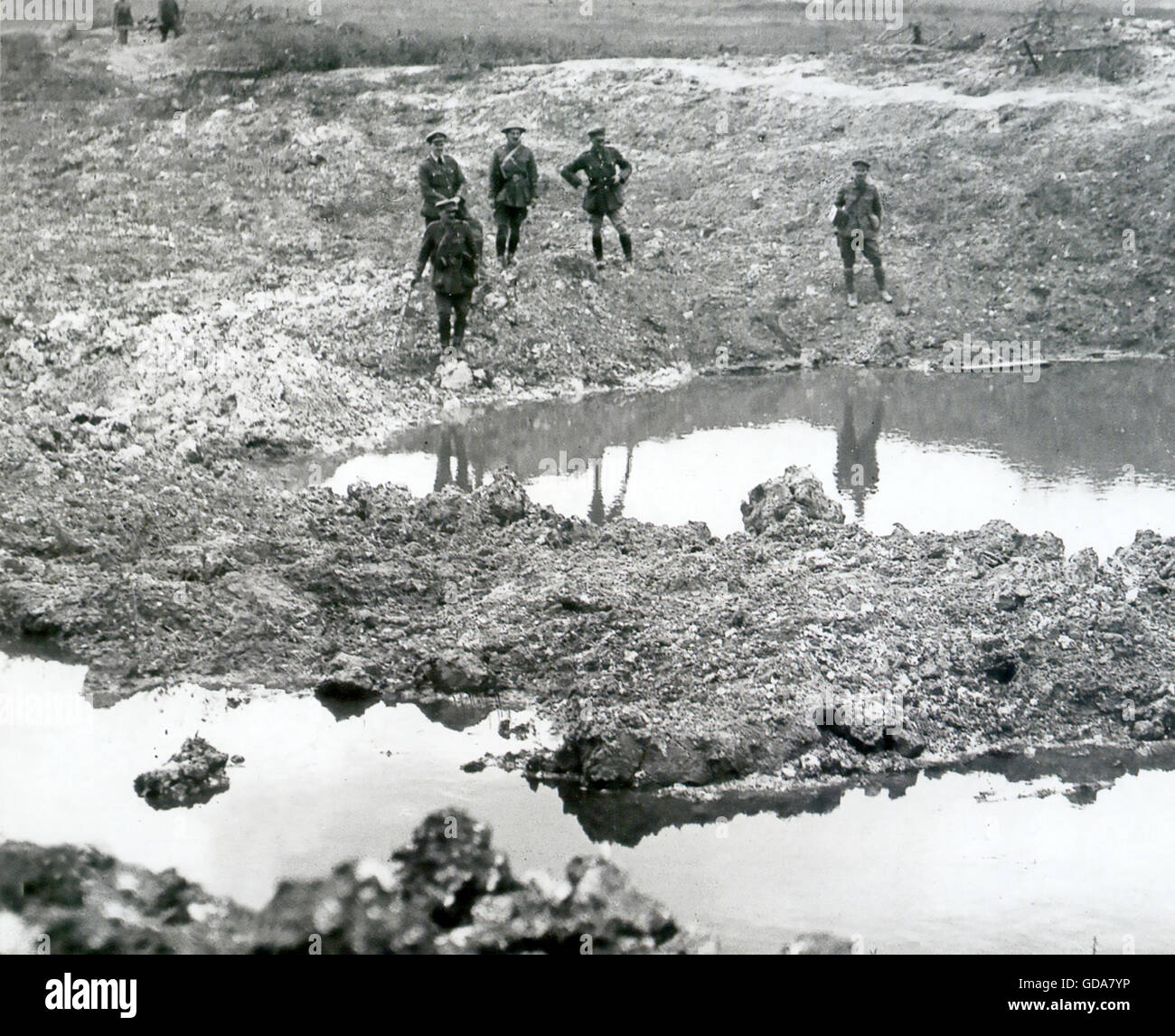 FIRST WORLD WAR  British officers and soldiers inspect a shell ravaged landscape in northern France - Stock Image