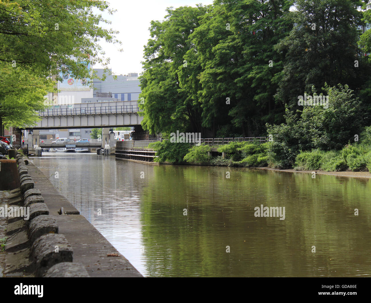 AALST, BELGIUM, JULY 9 2016: View of the river Dender as it runs through Aalst. The Dender is navigable for cargo Stock Photo