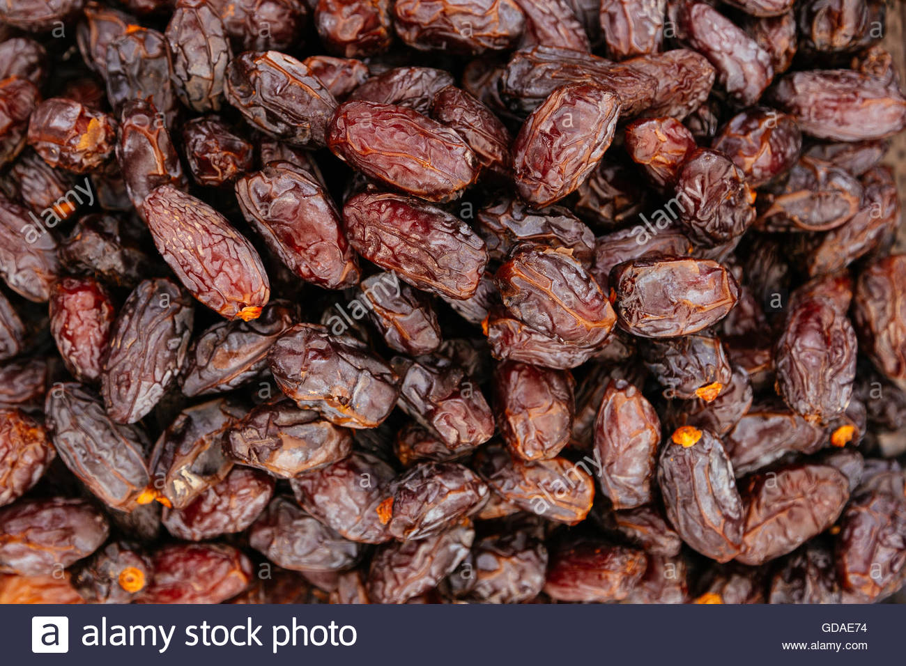 Dried organic date fruits background - Stock Image