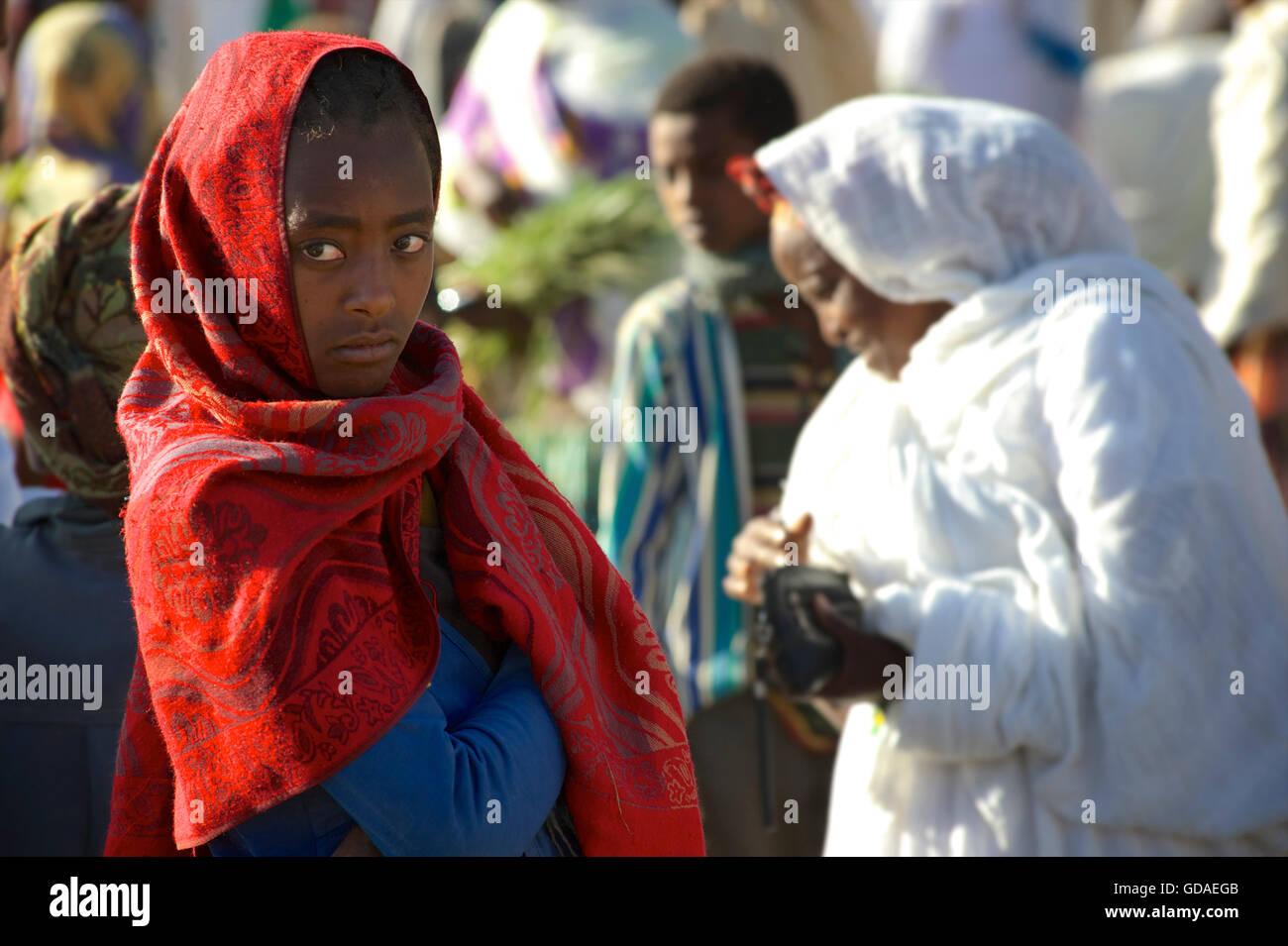 Ethiopian Christian girl in headcloth at Palm Sunday festivities, Axum, Tigray, Ethiopia. - Stock Image
