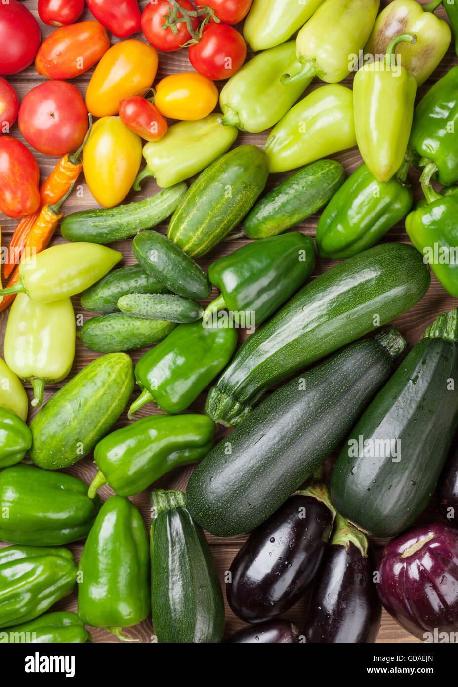 Fresh farmers garden vegetables on wooden table. Top view - Stock Image
