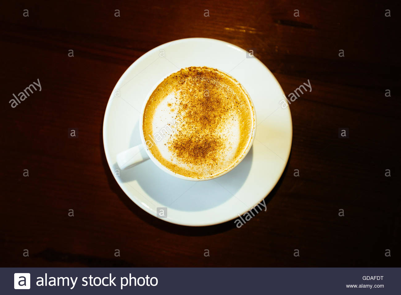 Cappuccino Coffee on Wooden table background - Stock Image