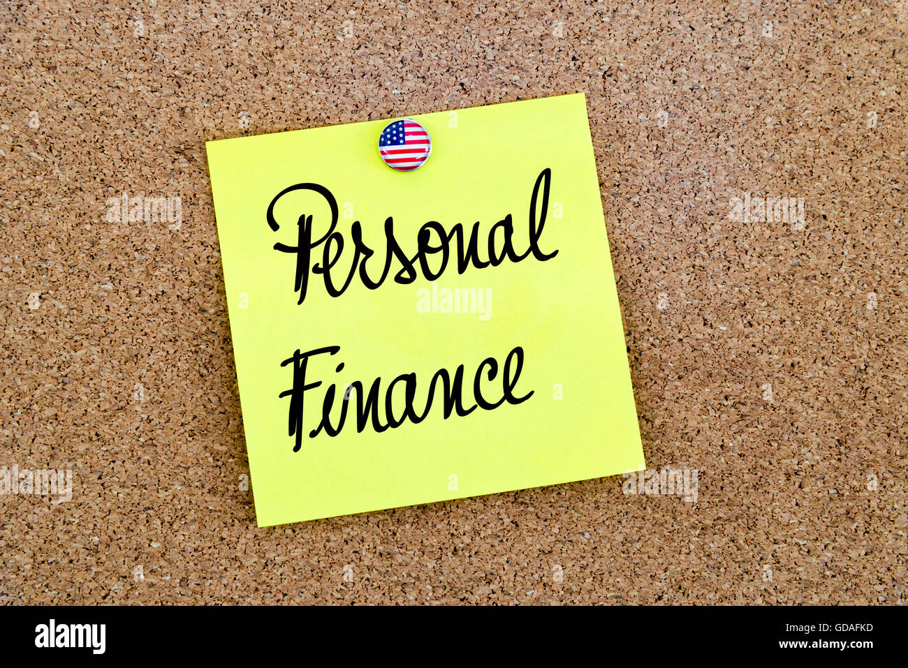 Written text Personal Finance over yellow paper note pinned on cork board - Stock Image