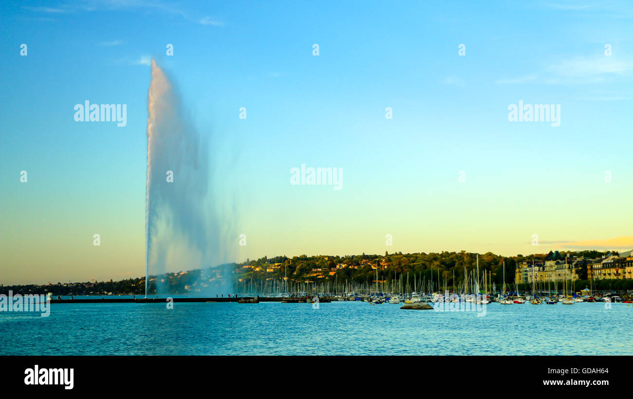 A view of Geneva's landmark as seen from Jardim Anlgais during a blue sky day.  The Jet d'Eau is a large - Stock Image
