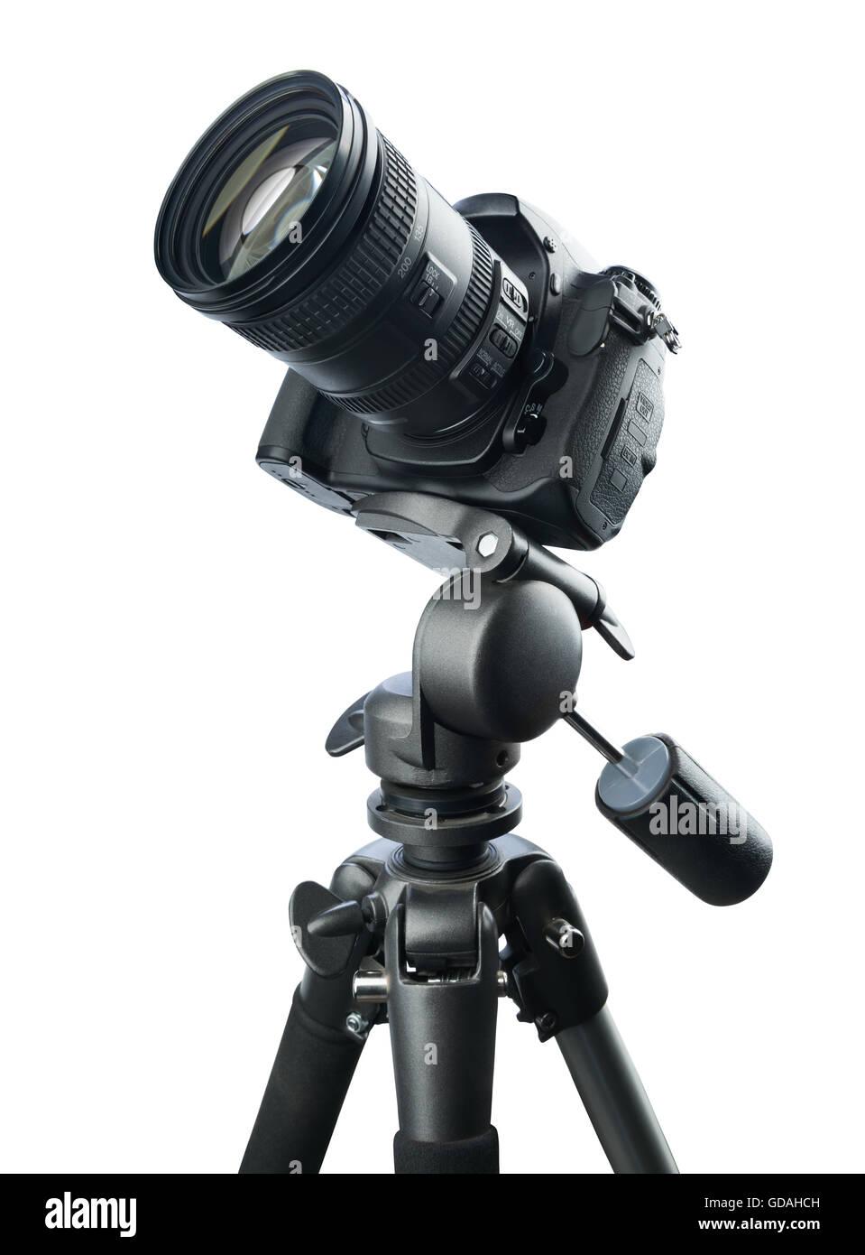DSLR camera on tripod, isolated on white background - Stock Image
