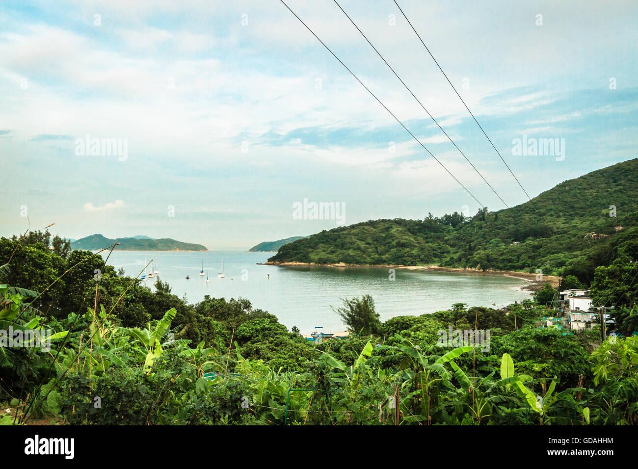 Lush green beach with tropical plants on Lantau Island, Hong Kong - Stock Image