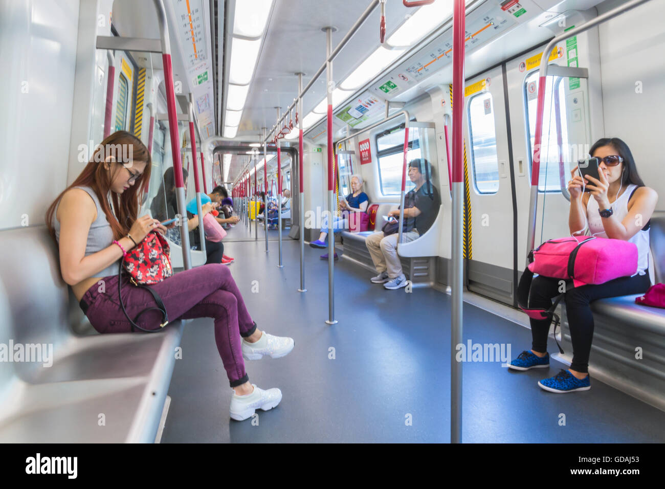 Passengers traveling on HK Tung Chung Line MTR - Stock Image