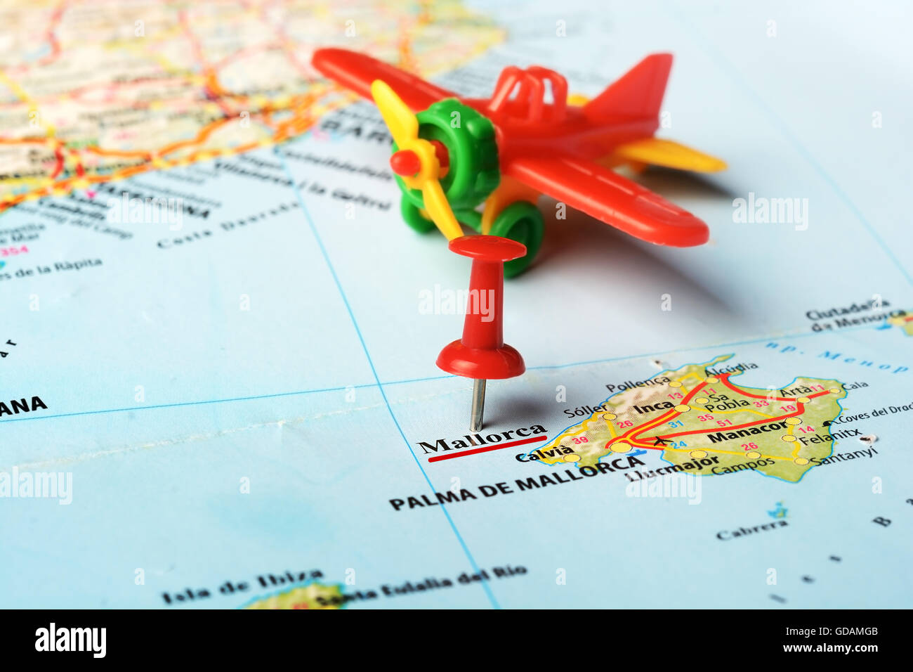Close Up Of Majorca Island Spain Map Pin And Airplane Toy Stock