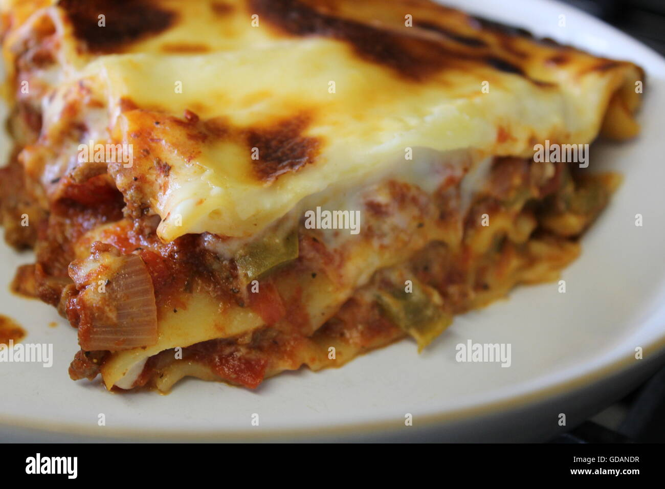 Homemade lasagne, home cooking, homemade cheese sauce, bolognese sauce, mince, onions, peppers, garlic, Italian - Stock Image
