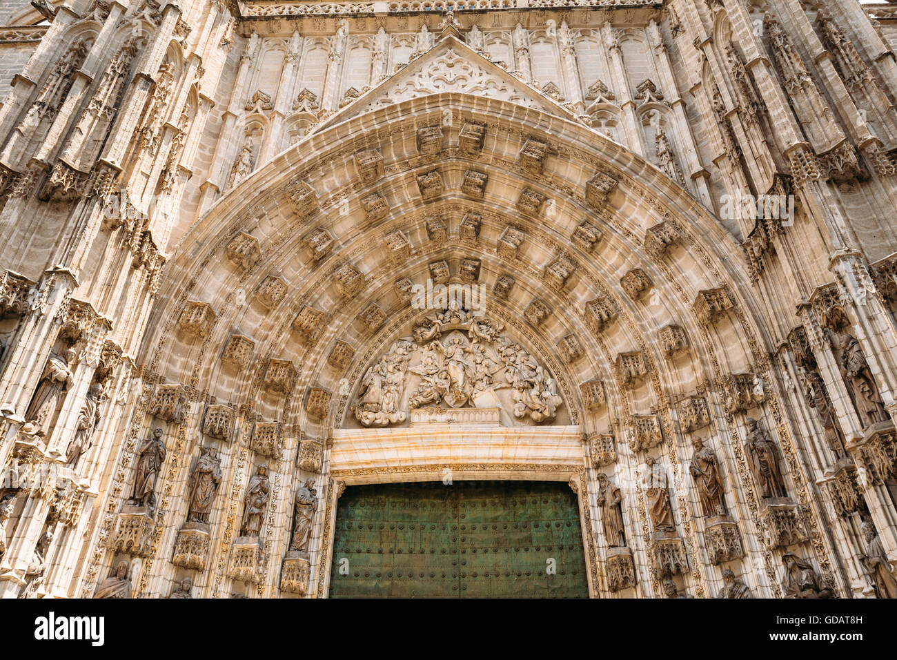 famous ancient architecture history cathedral entrance in seville spain detail of wall old ancient architecture famous landmark