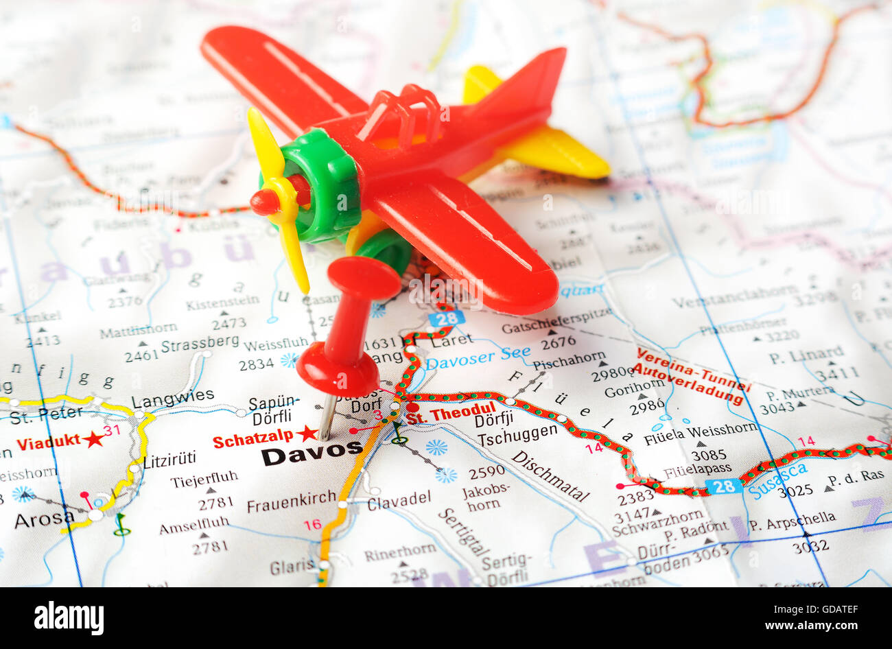 Close up of Davos, Swiss map with red pin and airplane toy Stock ...