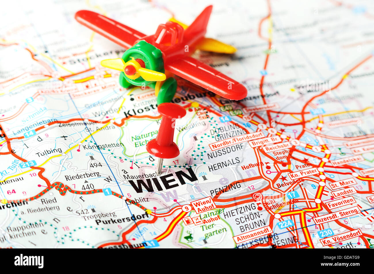 Close Up Of Wien Austria Map With Red Pin And Airplane Stock