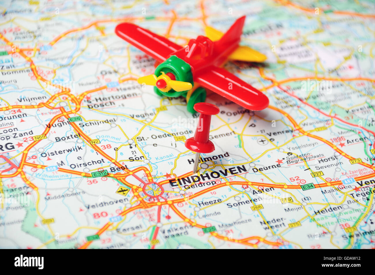 Close up of Eindhoven , Netherlands map with red pin and airplane ...