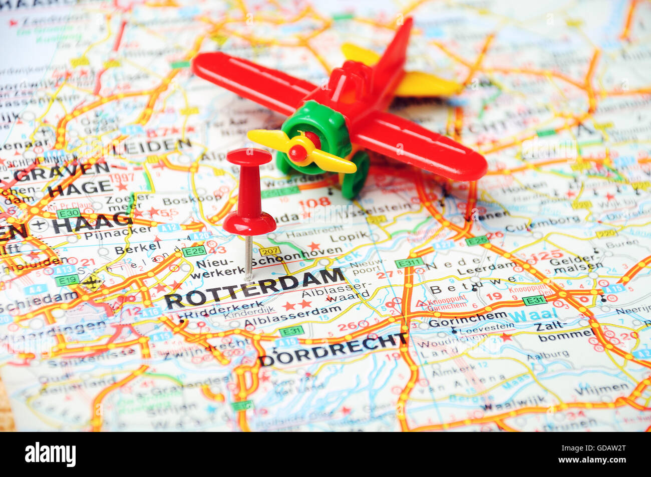 Close up rotterdam netherlands map stock photos close up rotterdam close up of rotterdam netherlands map with red pin and airplane toy travel concept gumiabroncs Gallery