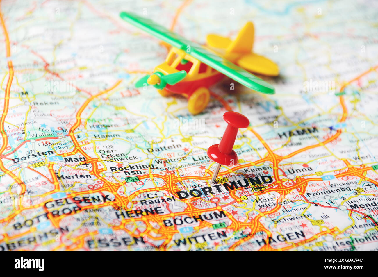 close up of dortmundgermany map with red pin and airplan travel concept