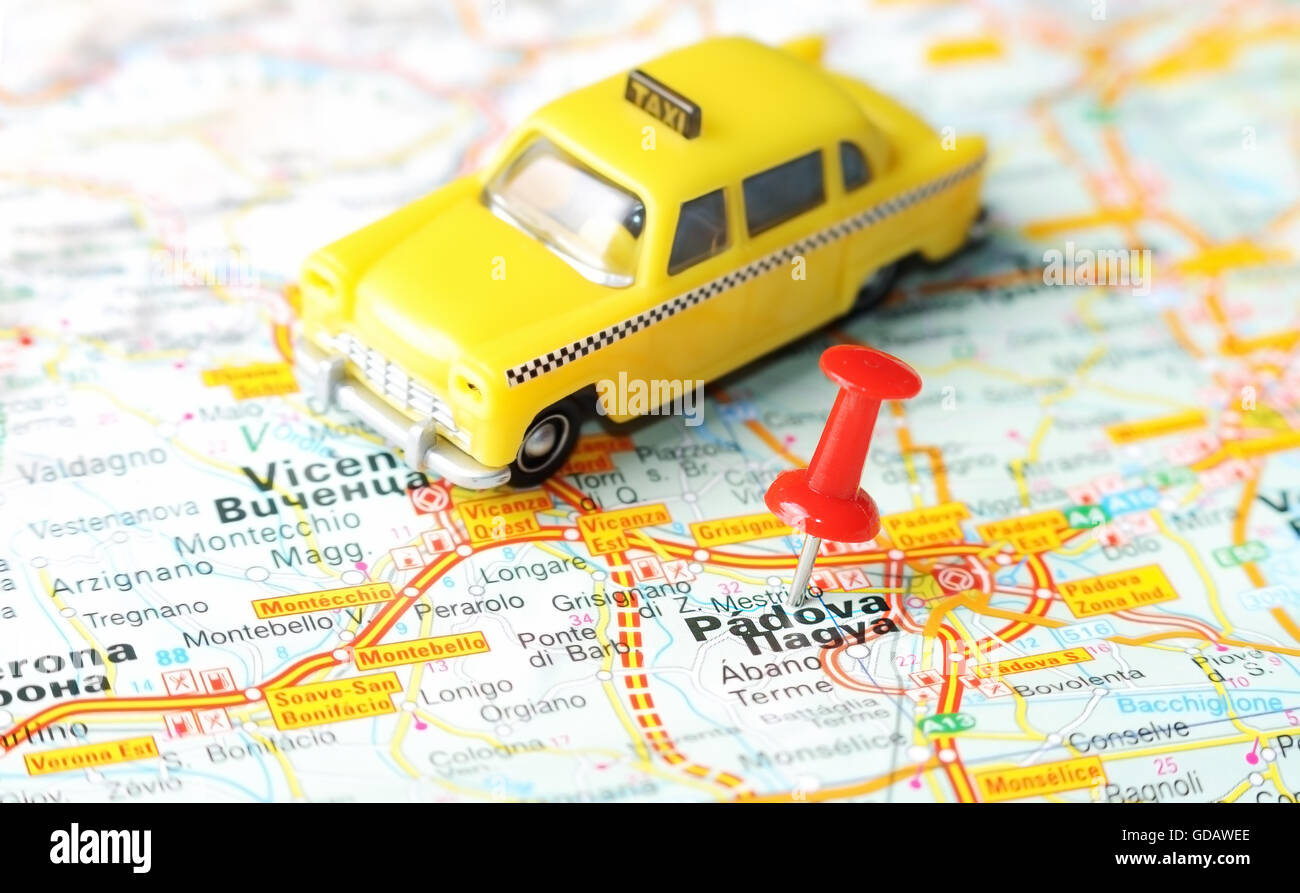 Close Up Of Padua Italy Map With Red Pin And A Taxi Travel Stock