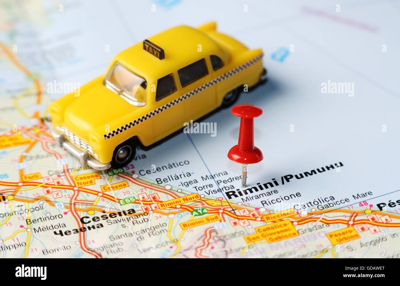 Close Up Of Rimini Italy Map With Red Pin And A Taxi Travel
