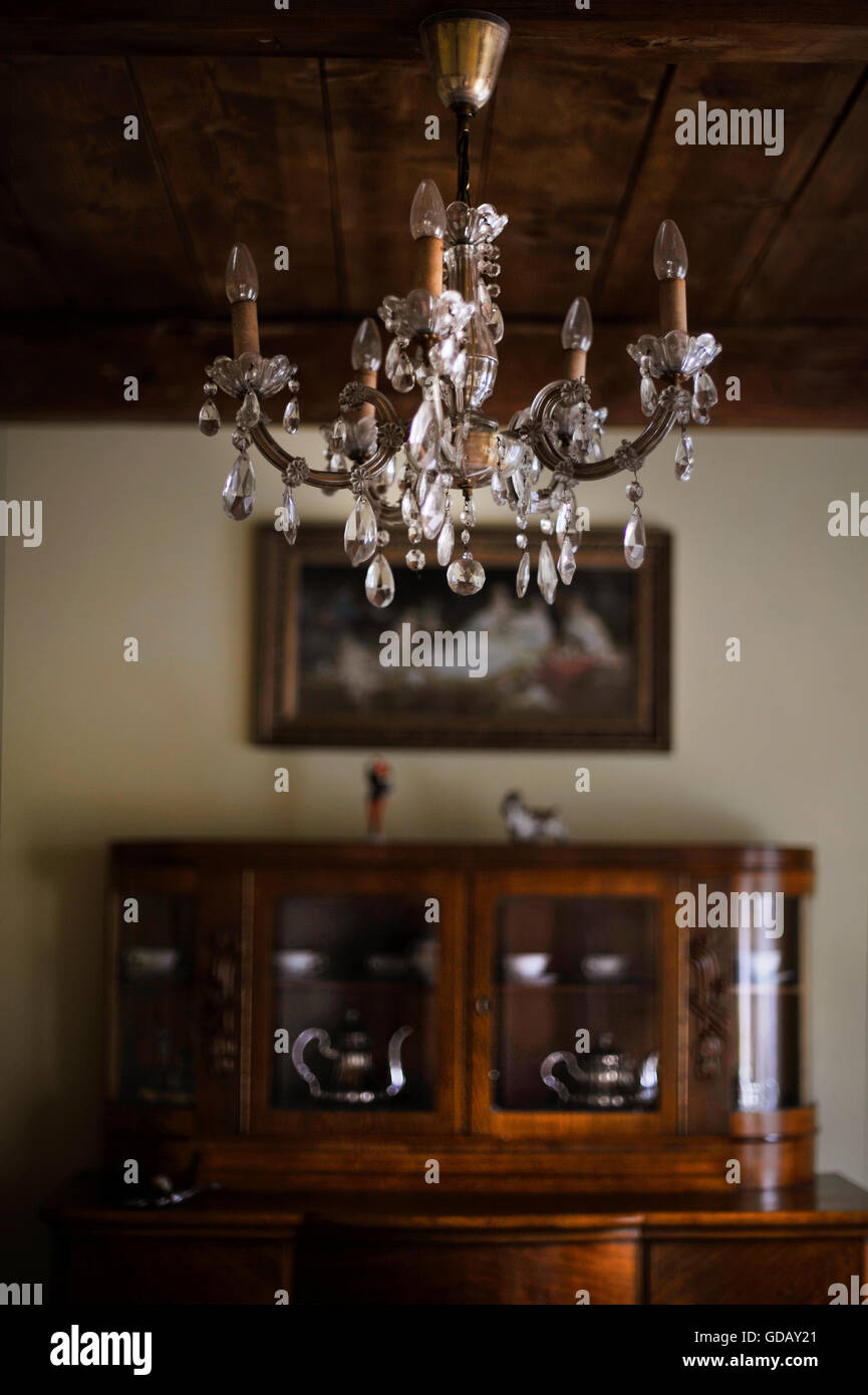 a beautiful sparkling chandelier in old interior - Stock Image