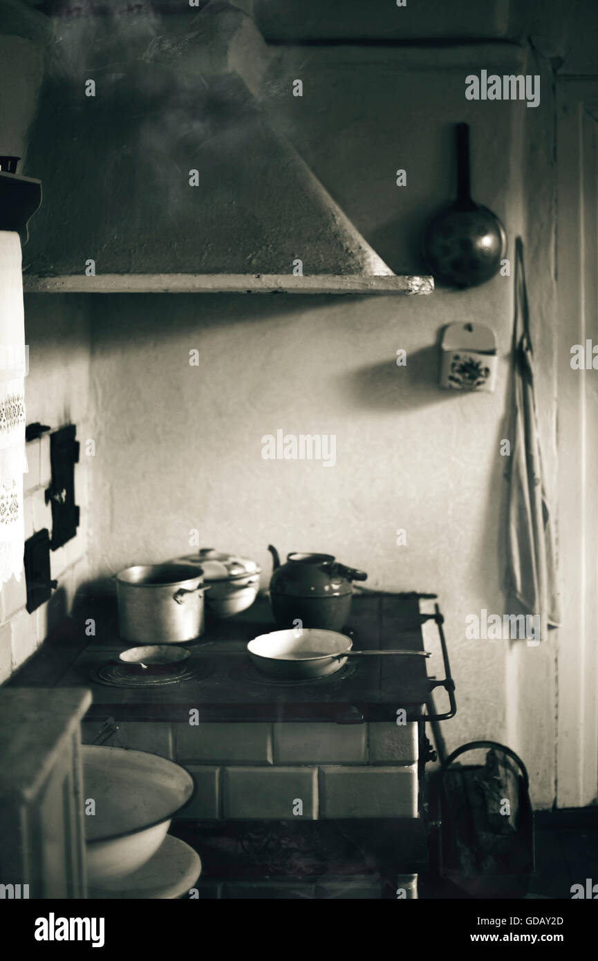 pots on the stove in an old kitchen - Stock Image