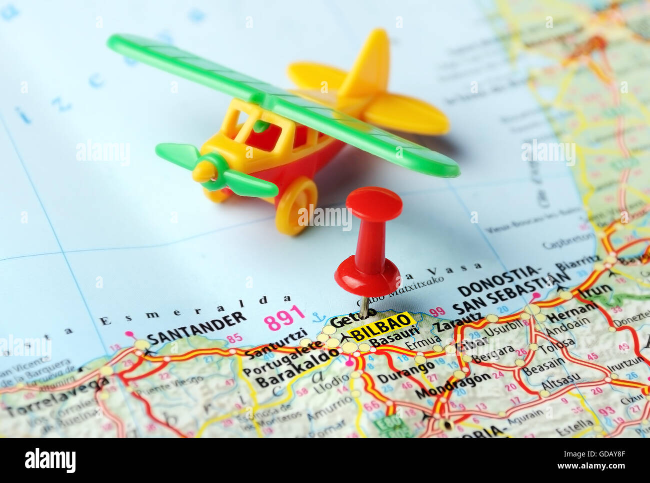 Close Up Of Bilbao Spain Map Airplane And Red Pin Travel Stock