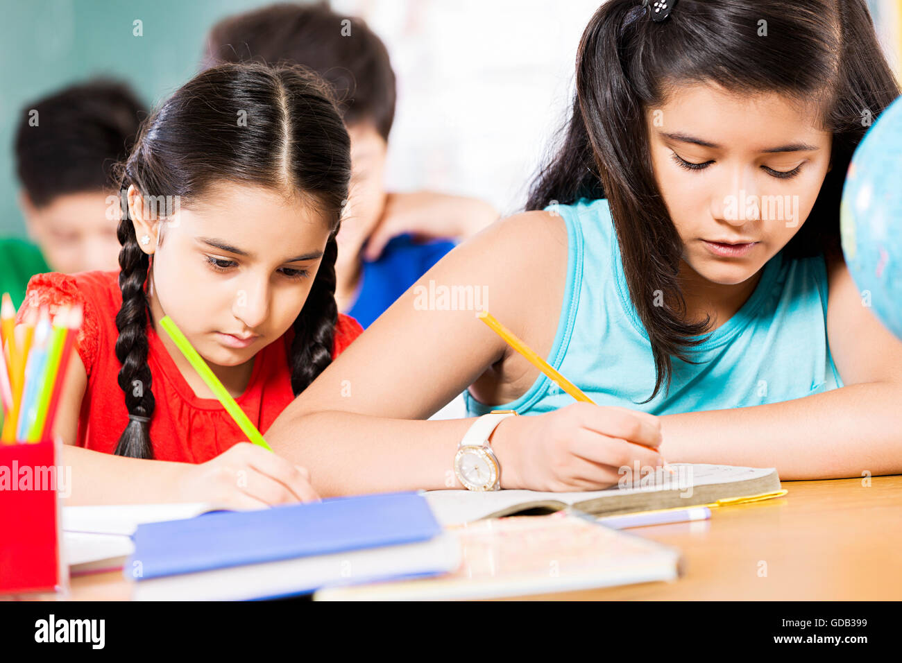 2 kids girls only school student studying in a classroom stock photo