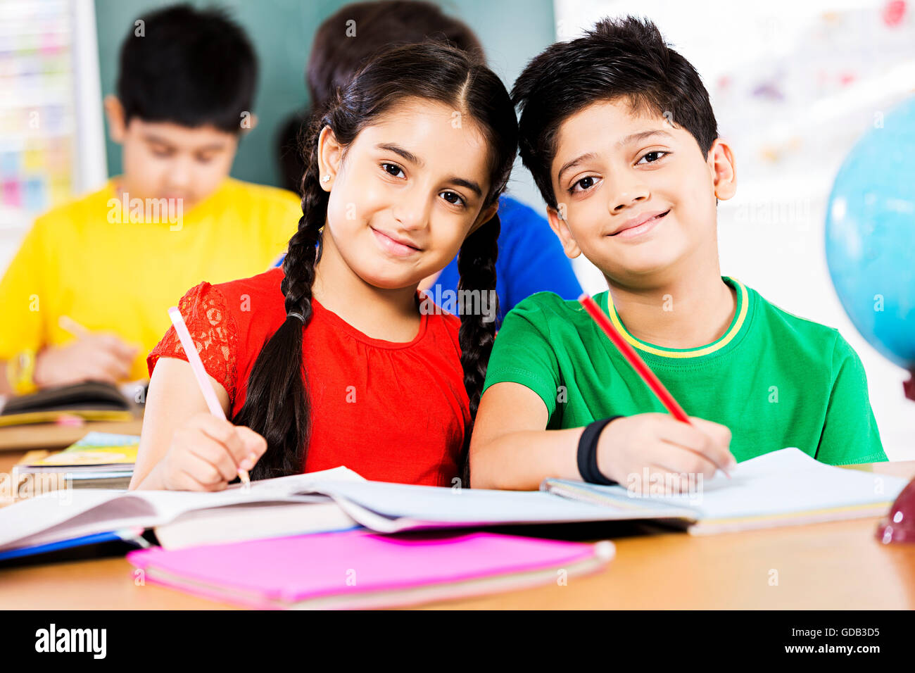 2 kids girl and boy friends school student studying in a classroom