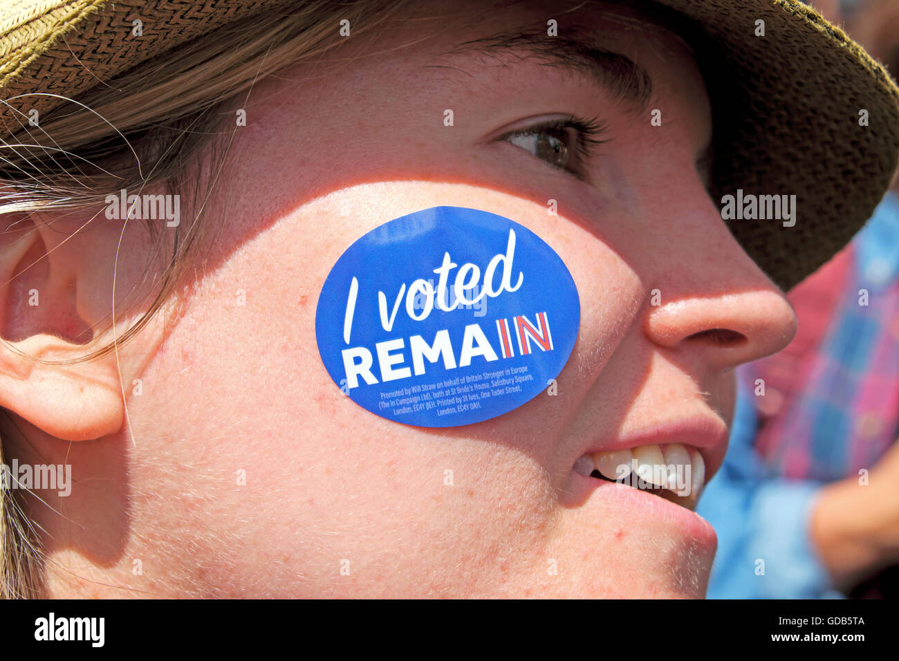 Young woman voter protestor wears an  'I voted RemaIn'  sticker on her face at Anti Brexit protest In London - Stock Image