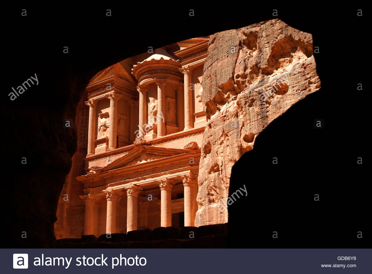 View of the Treasury (Al Khazneh) from inside cave at Petra in Jordan. - Stock Image