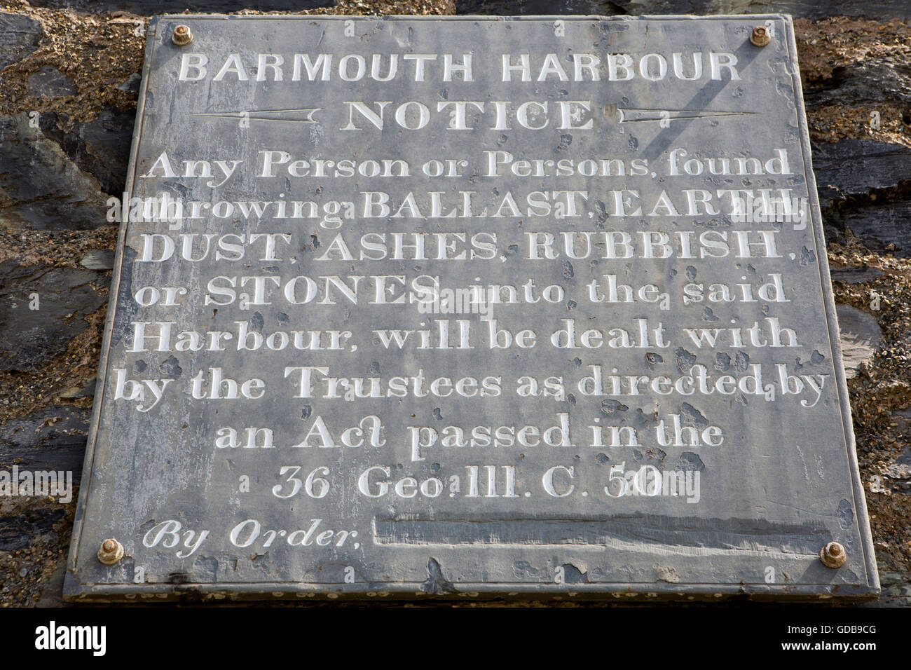 UK, Wales, Gwynedd, Barmouth, Harbourmaster's Office, C18th slate sign prohibiting dumping in water - Stock Image