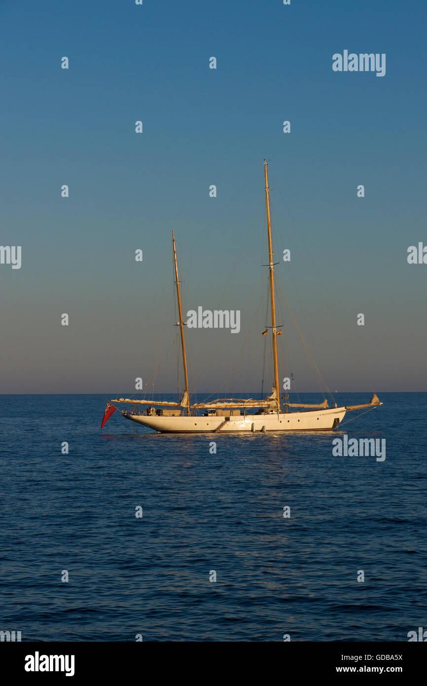 Yacht at Sunset ,Cala Portals Nous, Mallorca ,Balearic islands,Spain. - Stock Image