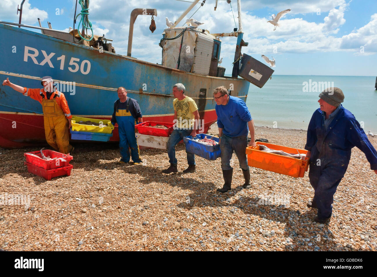 Hastings fishermen unloading catch of fish East Sussex England Britain UK - Stock Image