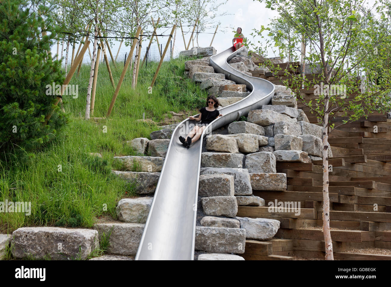 Slide Hill on Governors Island, at 36 feet tall, is home to four slides, including the longest slide in New York City. Stock Photo