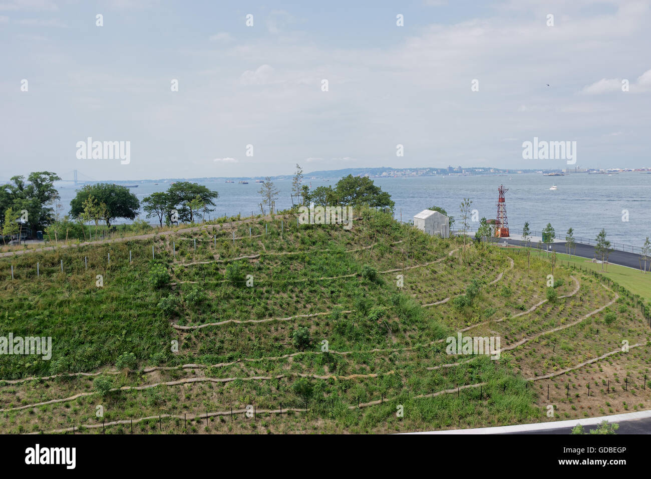 Governors Island's Discovery Hill overlooking New York harbor is one of four man-made hills on the island, designed by West 8. Stock Photo