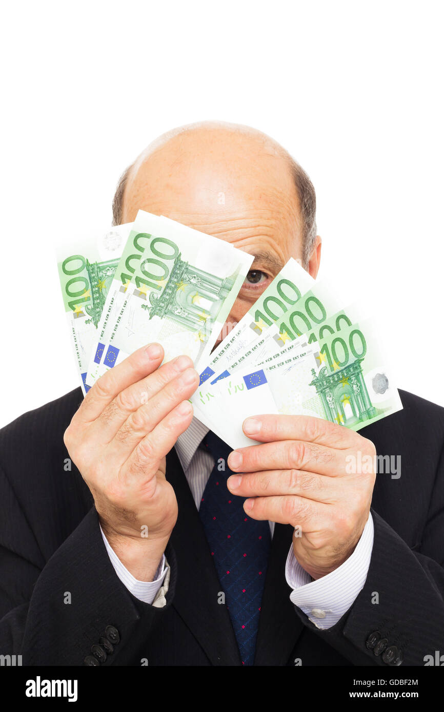 Man hiding behind the earned money - Stock Image