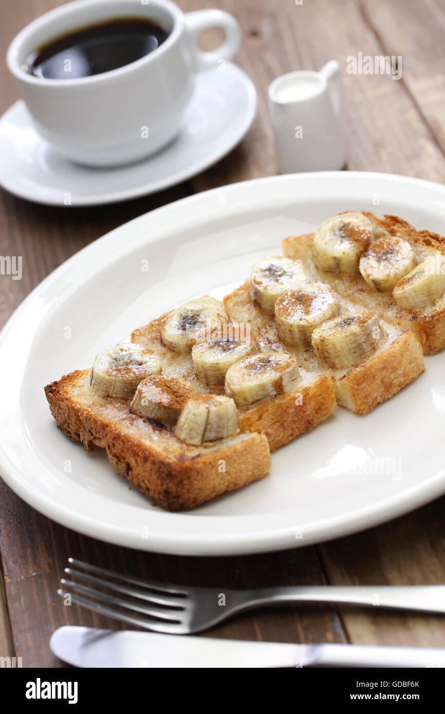 cinnamon sugar banana toast and a cup of coffee - Stock Image