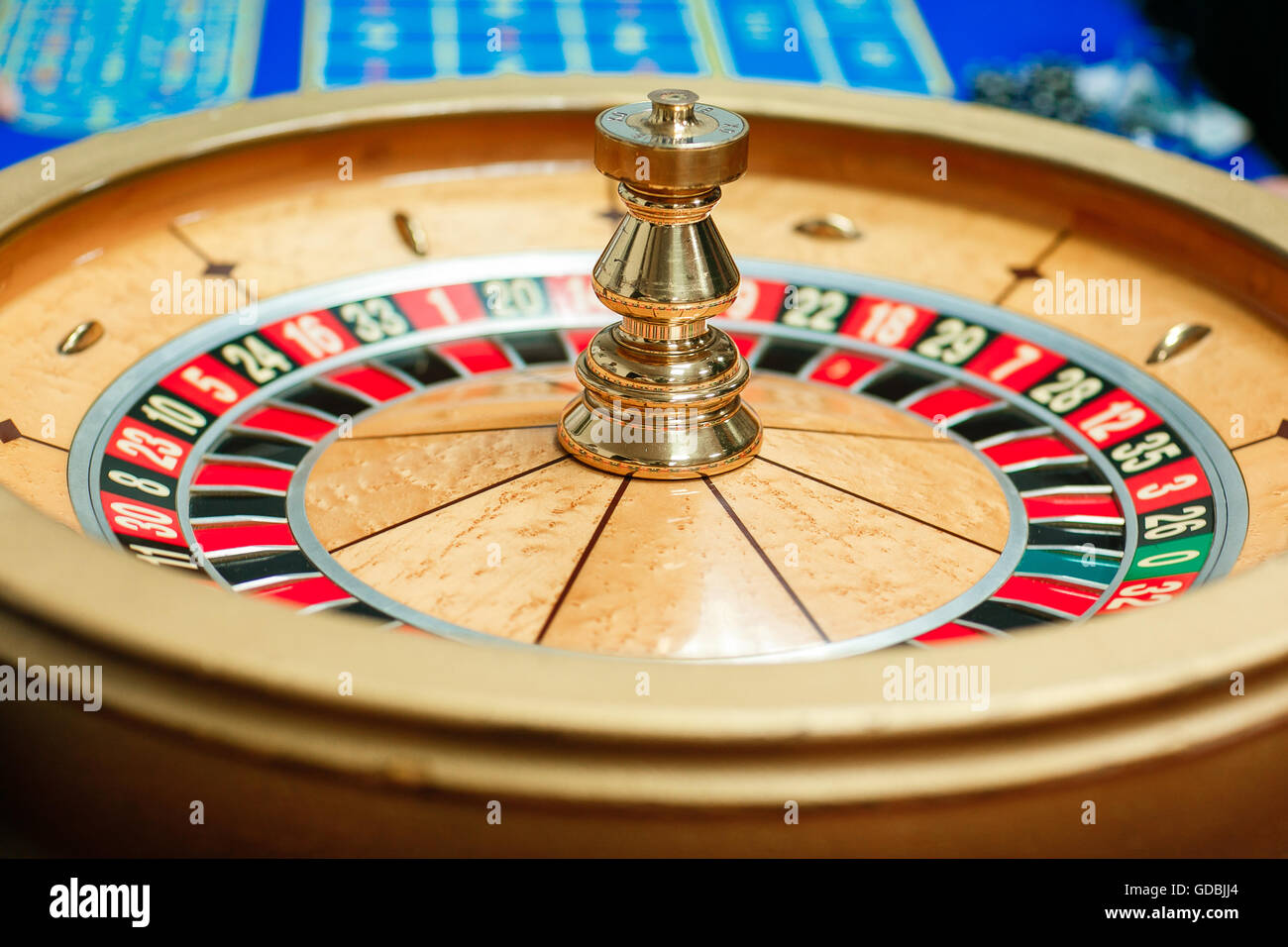green roulette table with colored chips ready to play. - Stock Image