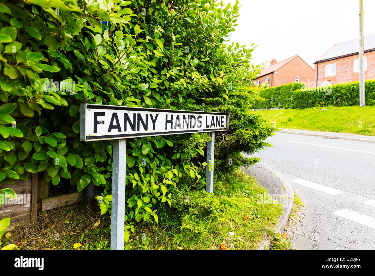 Funny amusing road signs UK sign unusual weird strange Fanny Hands Lane Ludford Lincolnshire UK England names roads - Stock Image