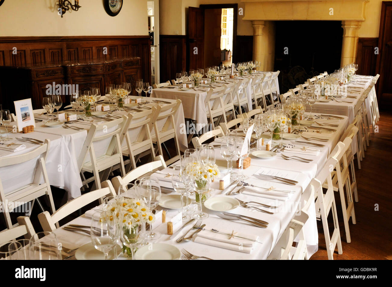 Tables laid out for a wedding reception - Stock Image