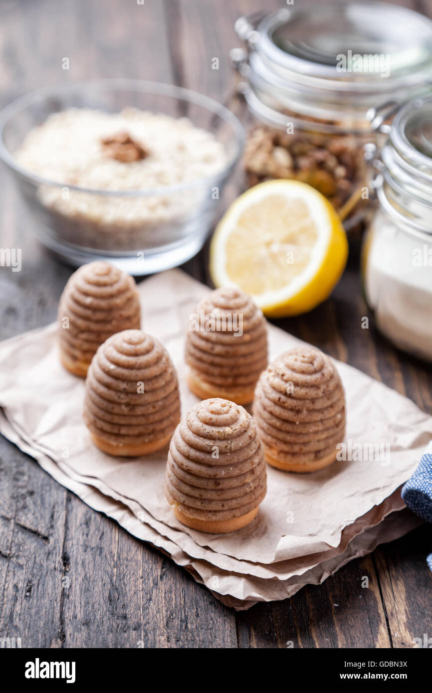 Traditional bee nest cake and ingredients on wooden background - Stock Image