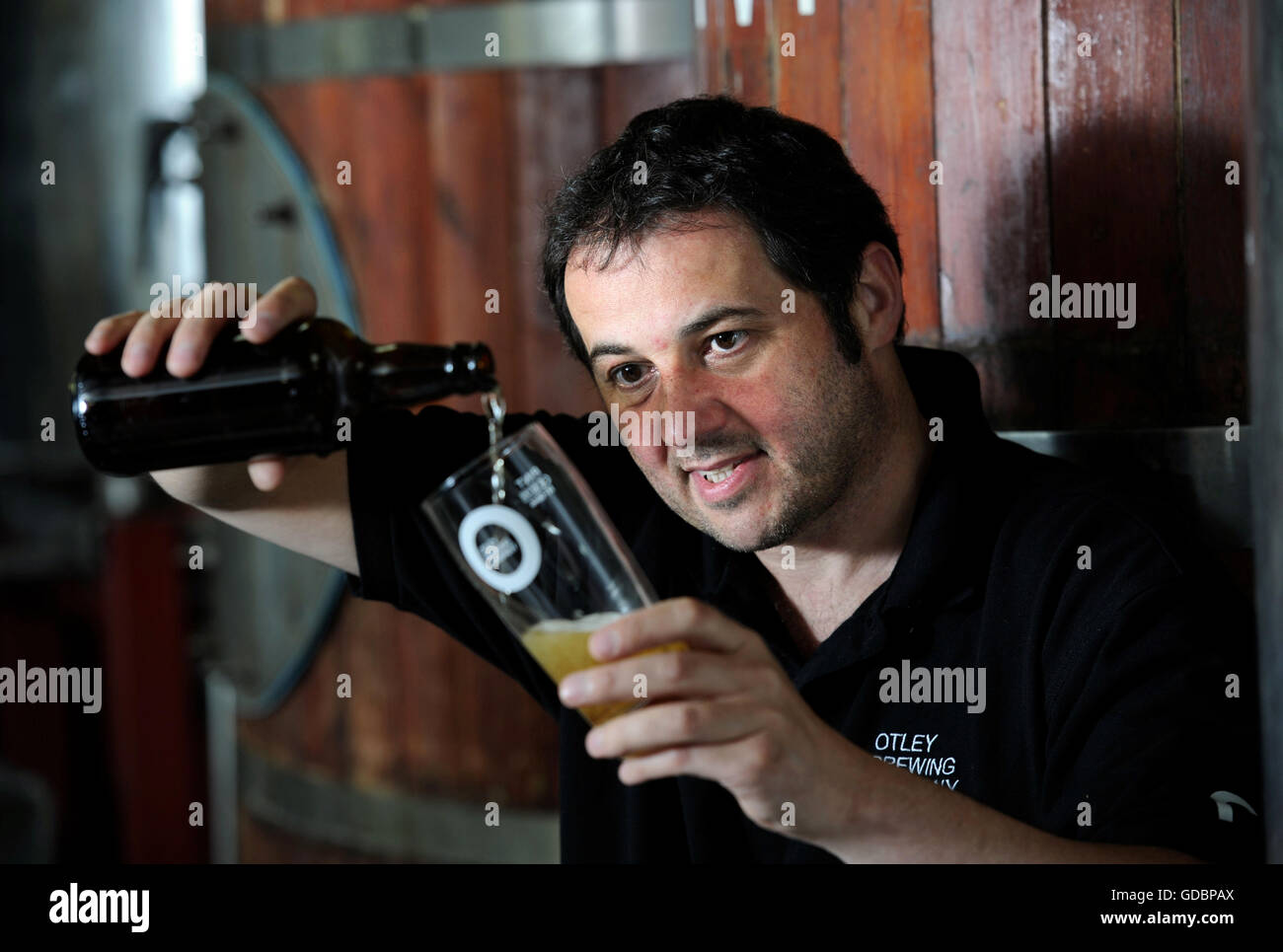 Nick Otley, MD of the Otley Brewing Company in Cilfynydd near Pontypridd, Wales sampling his beer UK - Stock Image