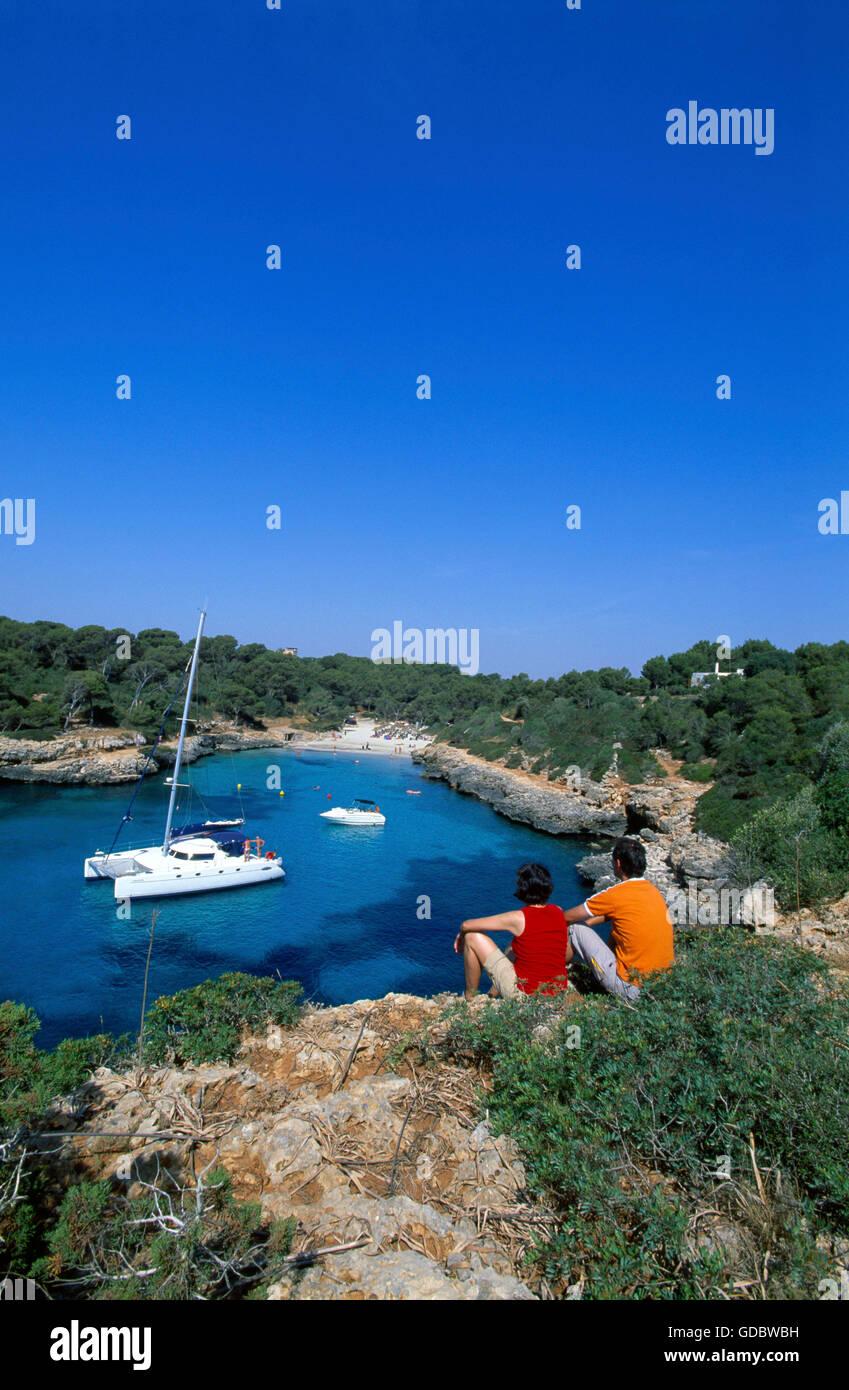 Couple at Cala Sa Nau, Mallorca, Balearic Islands, Spain - Stock Image