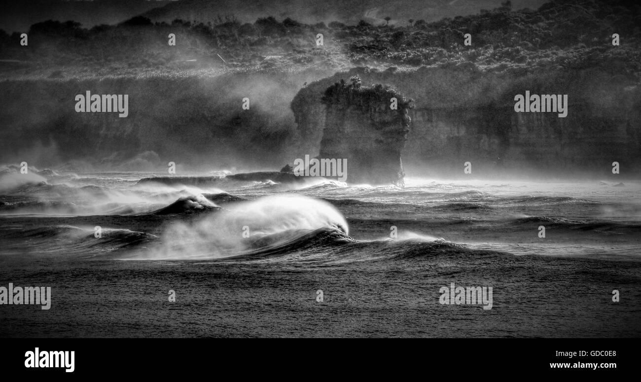 Pancake rock,sea,New Zealand,south hemisphere,wave,foam,surf,drama,black and white,monster wave,south island,west - Stock Image