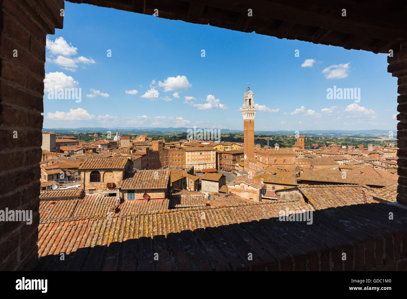 Siena, Siena Province, Tuscany, Italy.  Piazza del Campo and Torre del Mangia.  High view. - Stock Image