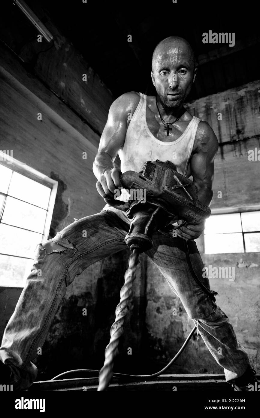concepts,body cult,hard,guy,sweat,man,strength,muscles,workers,drill - Stock Image