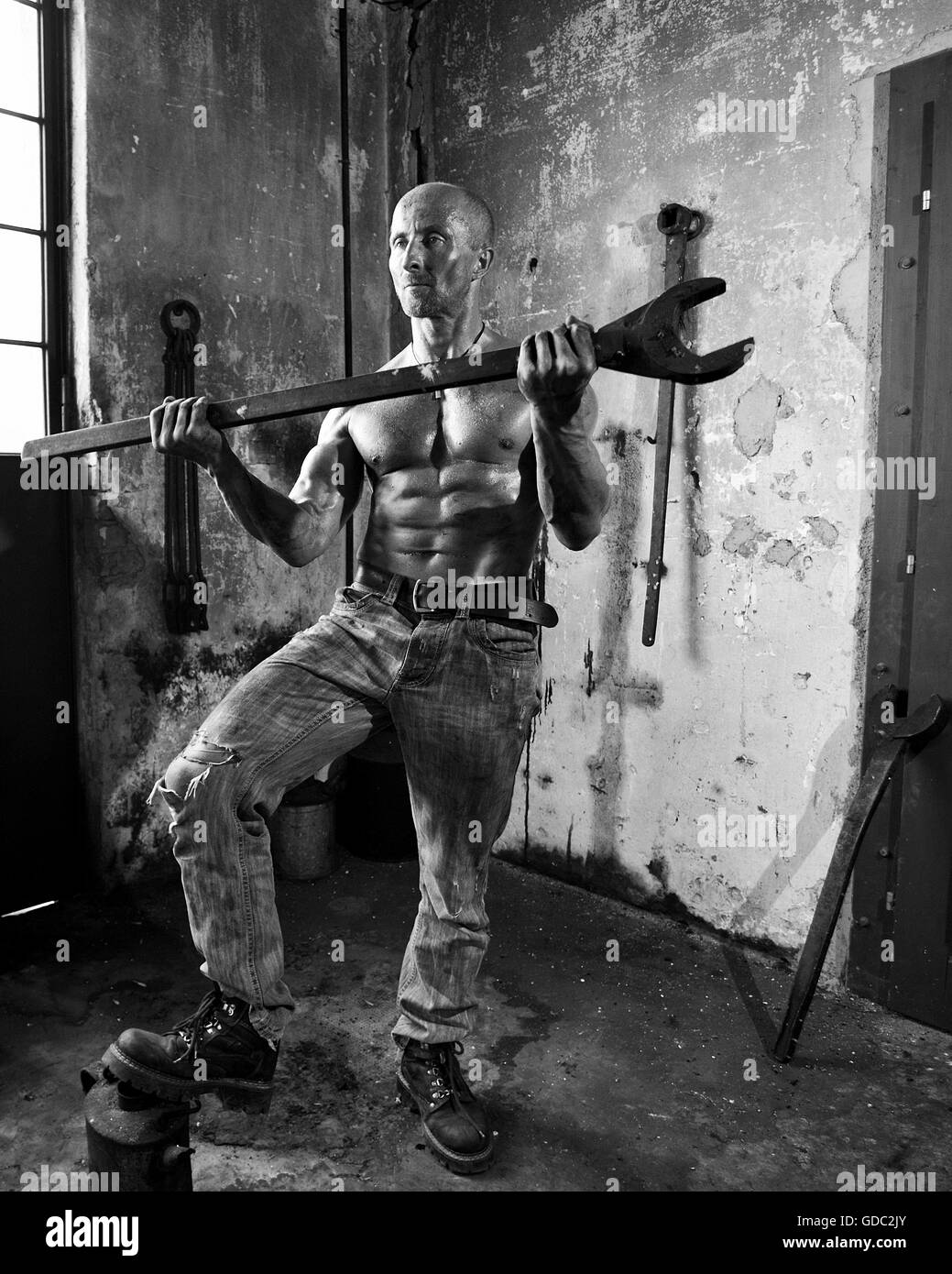 concepts,body cult,hard,guy,sweat,man,strength,muscles,workers,wrenches - Stock Image