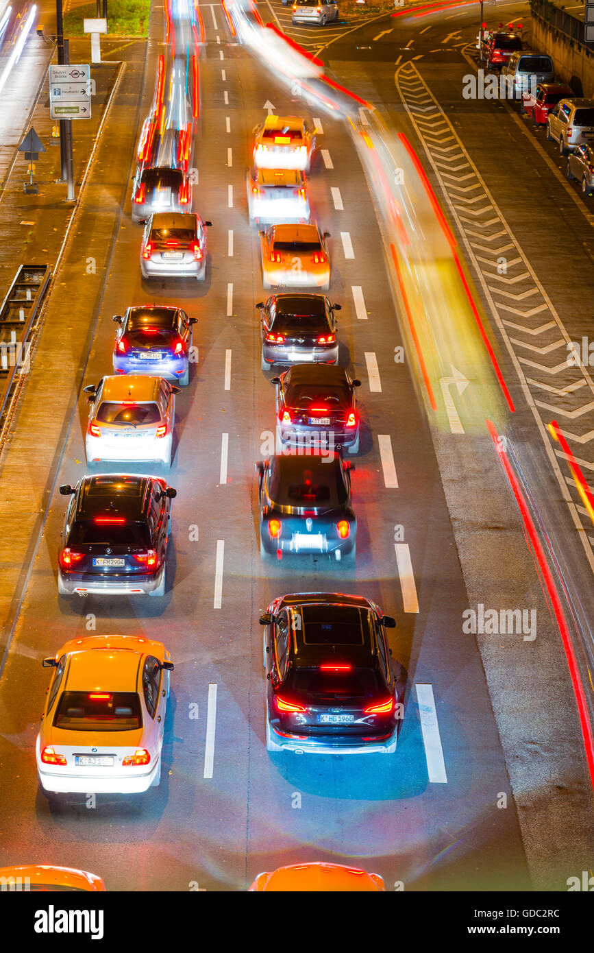 Cars,Automobiles,rush-hour,traffic,blur,brake lights,Germany,Europe,automobiles,Cologne,night,North Rhine-Westphalia, - Stock Image