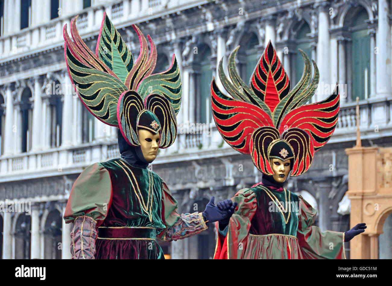 VENICE,ITALY - Matching carnival couple in St Marks Square the 2015 Venice Carnival: - Stock Image