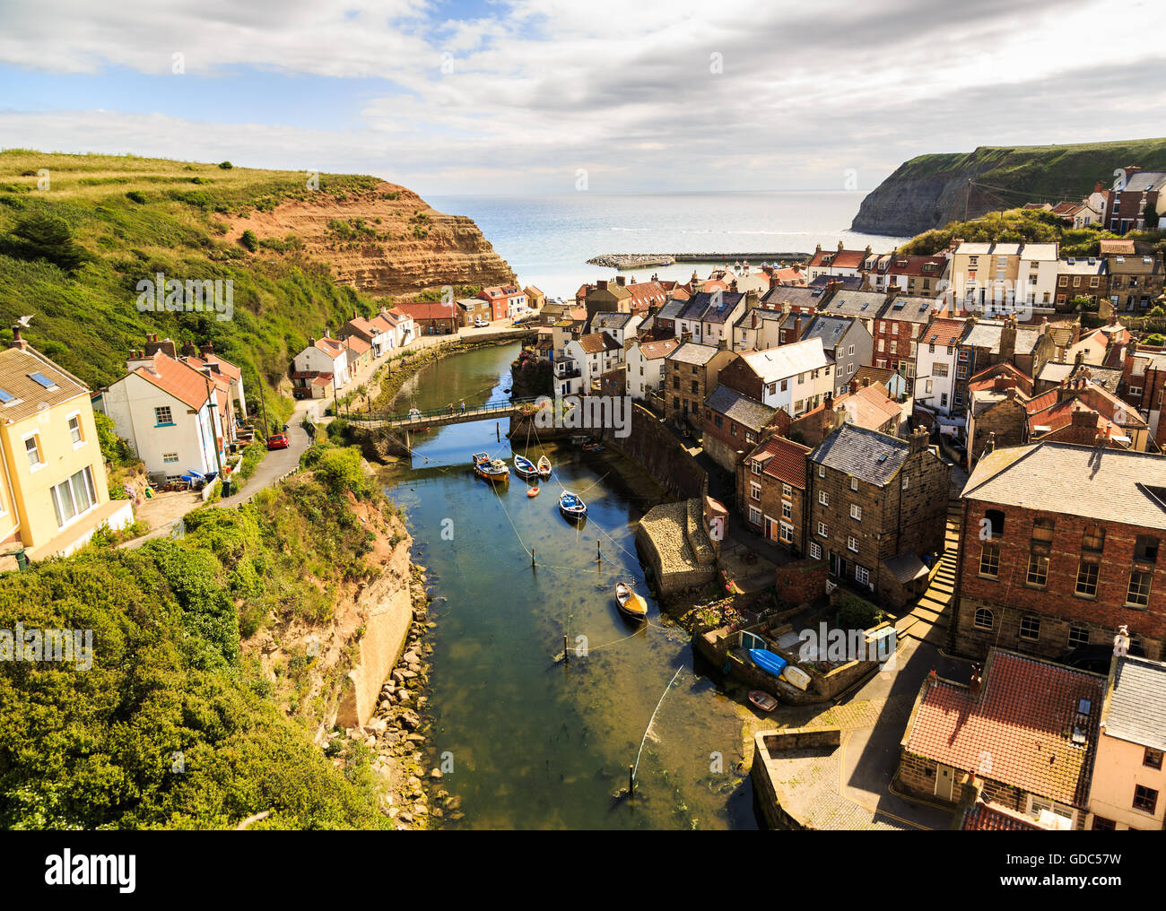 View of Staithes, from a high viewpoint, showing the beck and the town. - Stock Image