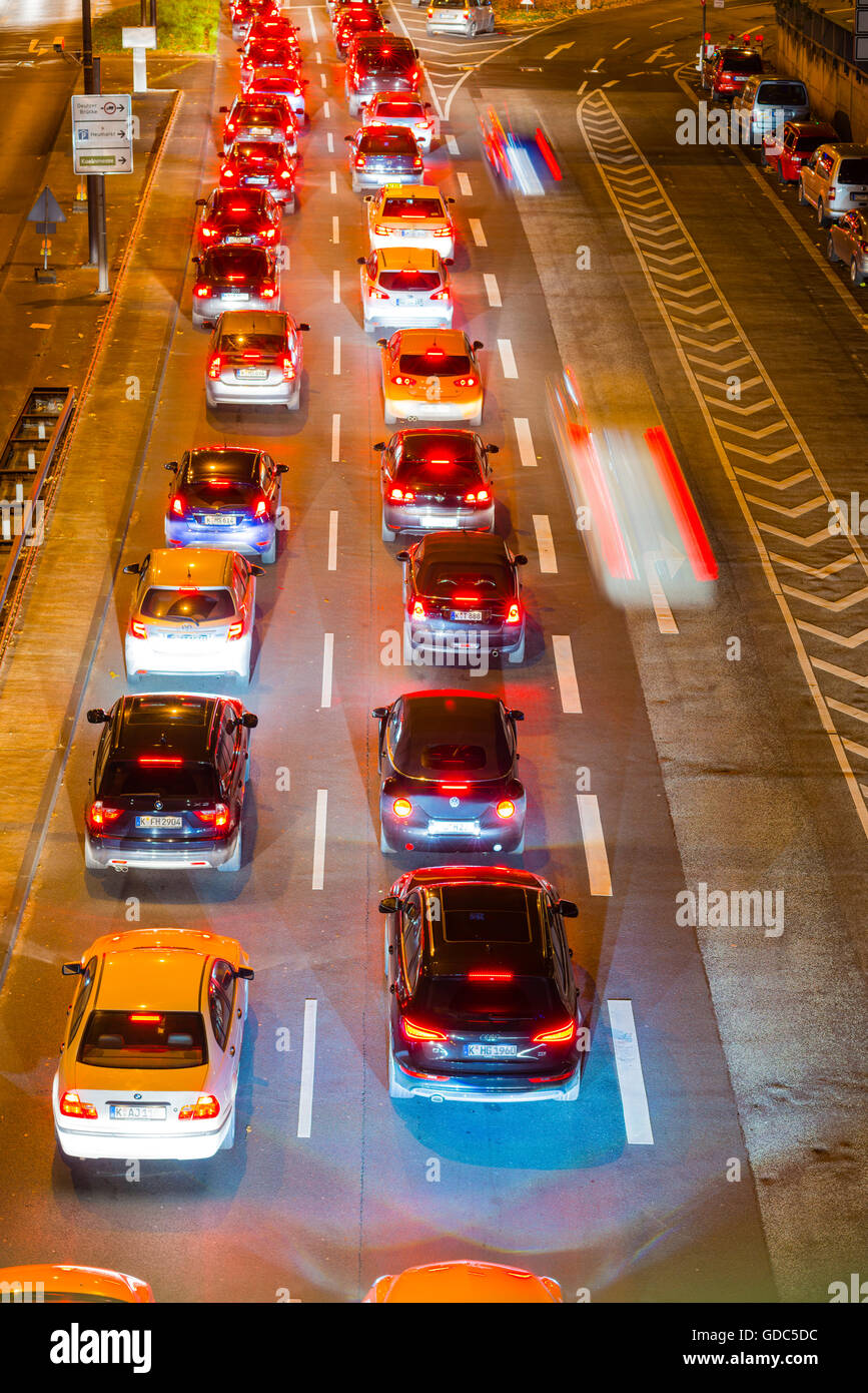 Cars,Automobiles,rush-hour,traffic,blur,brake lights,Germany,Europe,automobiles,Cologne,night,North Rhine-Westphalia, - Stock Image